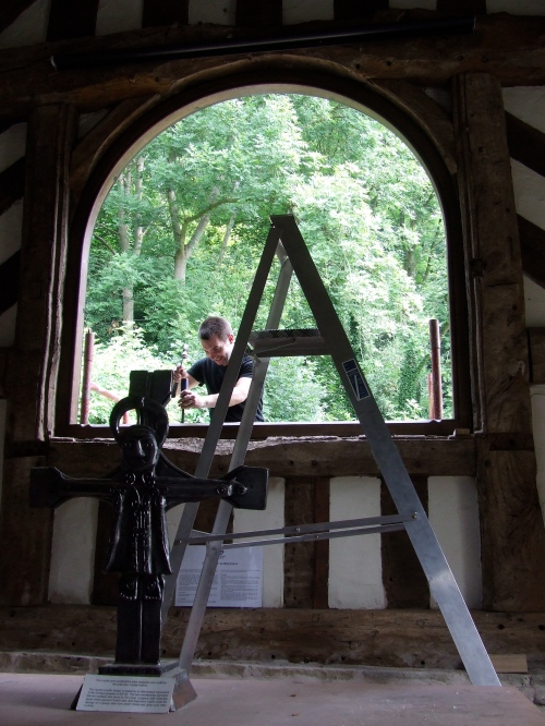 By midday the old window is gone and the new frame is being installed. Photo: Artemisia