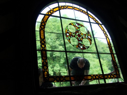 Steve and Rob put the finishing touches to the new window. Photo: Artemisia.