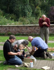 Family working together to make B+B boxes. Photo: Artemisia