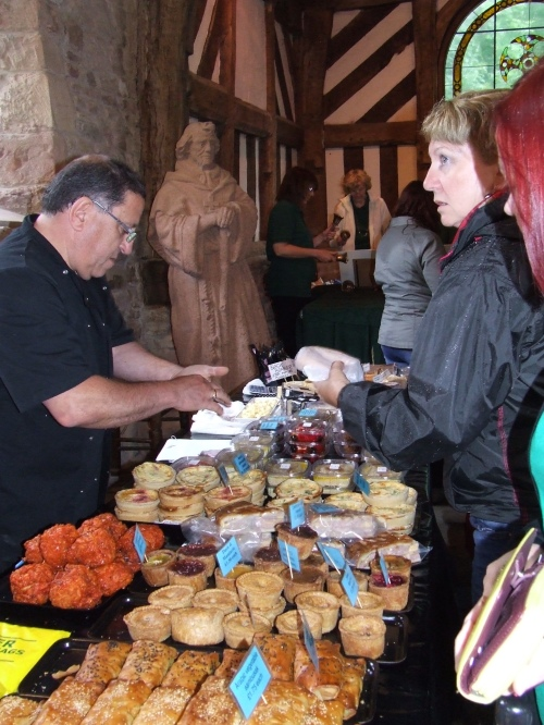 St. Chad watches, the T'insole Bells sound and festival goers are tempted by the delicious wares for sale.