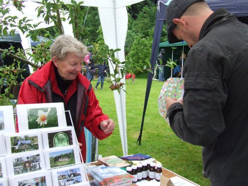 Cards and comfrey oil for sale on one of the Friends of Chadkirk stalls.
